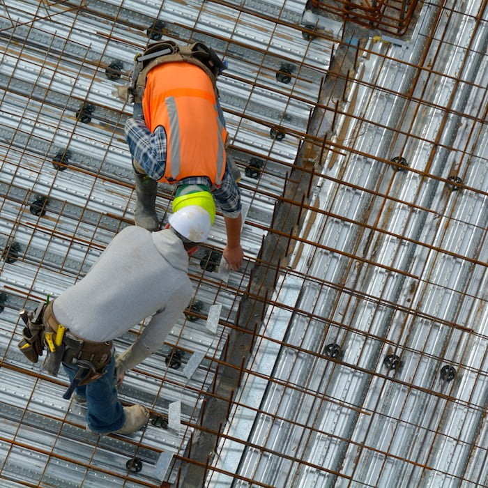 Civil Engineer Inspecting The Work Progress Of A Worker In A Construction Site